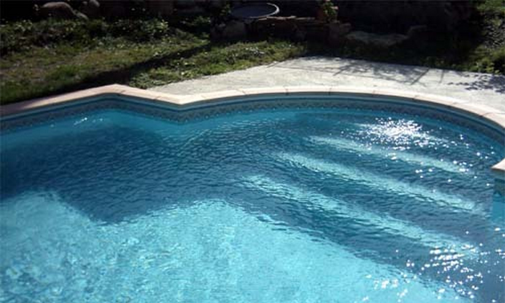 La piscine en b ton infiniment personnalisable for Realisation piscine beton